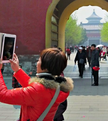Chinese woman with iPad